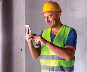 A Lead Bank Civic Contractor Funding client checking his bank account on his mobile phone
