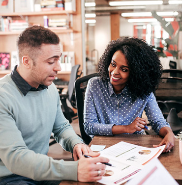 couple reviewing financial documents and statements